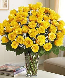 Brighten any occassion with bright yellow roses!