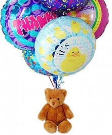 Six mylar balloons attached to a teddy bear! Be sure to tell us the occasion!