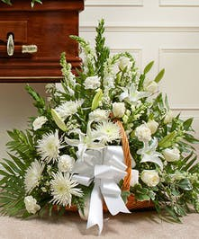 Send a message of sympathy, love and hope with this basket of white flowers