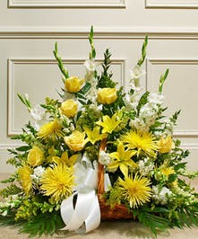fireside basket arrangement creates a touching tribute that beautifully conveys your sympathy and support