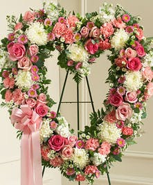 A mix of pinks and whites come together to create a beautiful standing open heart