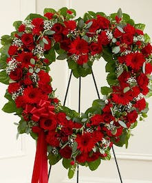 A mix of various red flowers creates a beautiful standing open heart