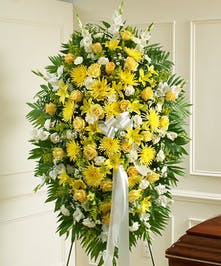 This Sympathy Standing Spray, in yellow and white, is a beautiful reflection of your sympathy and support