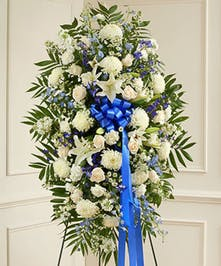 Beautiful blue and white flowers offer a comforting symbol of your heartfelt compassion and support