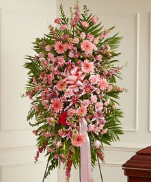 This Sympathy Standing Spray, in shades of pink, is a beautiful symbol of your sympathy and support