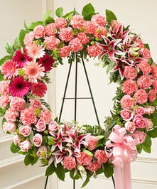 This pink standing wreath perfectly expresses your love and concern at this difficult time