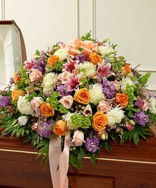 Send an elegant expression of your love and a touching tribute to a loved one with this pastel-hued casket cover arrangement