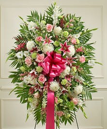 This Sympathy Standing Spray, crafted using elegant pastel blooms, is a beautiful symbol of your sympathy and support.