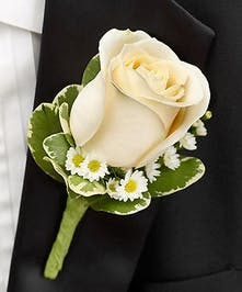 A classic white rose boutonniere