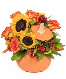 Rustic autumn flowers are stunning in a ceramic pumpkin that looks like it just came from the patch.