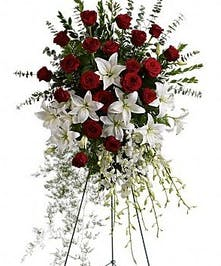 Red roses, white lilies and cascading white orchids