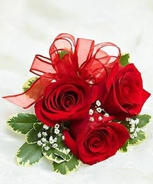 A stunning red rose wrist corsage that will make her the hit of the party