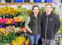 David and Jackie Levine, store owners, pose with several lovely bouquets
